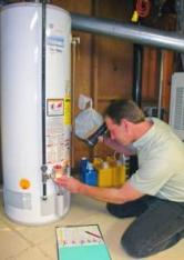 plumber in Pinole repairs a water heater that won't turn on